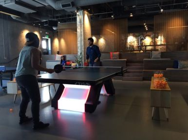 My friends playing ping pong.